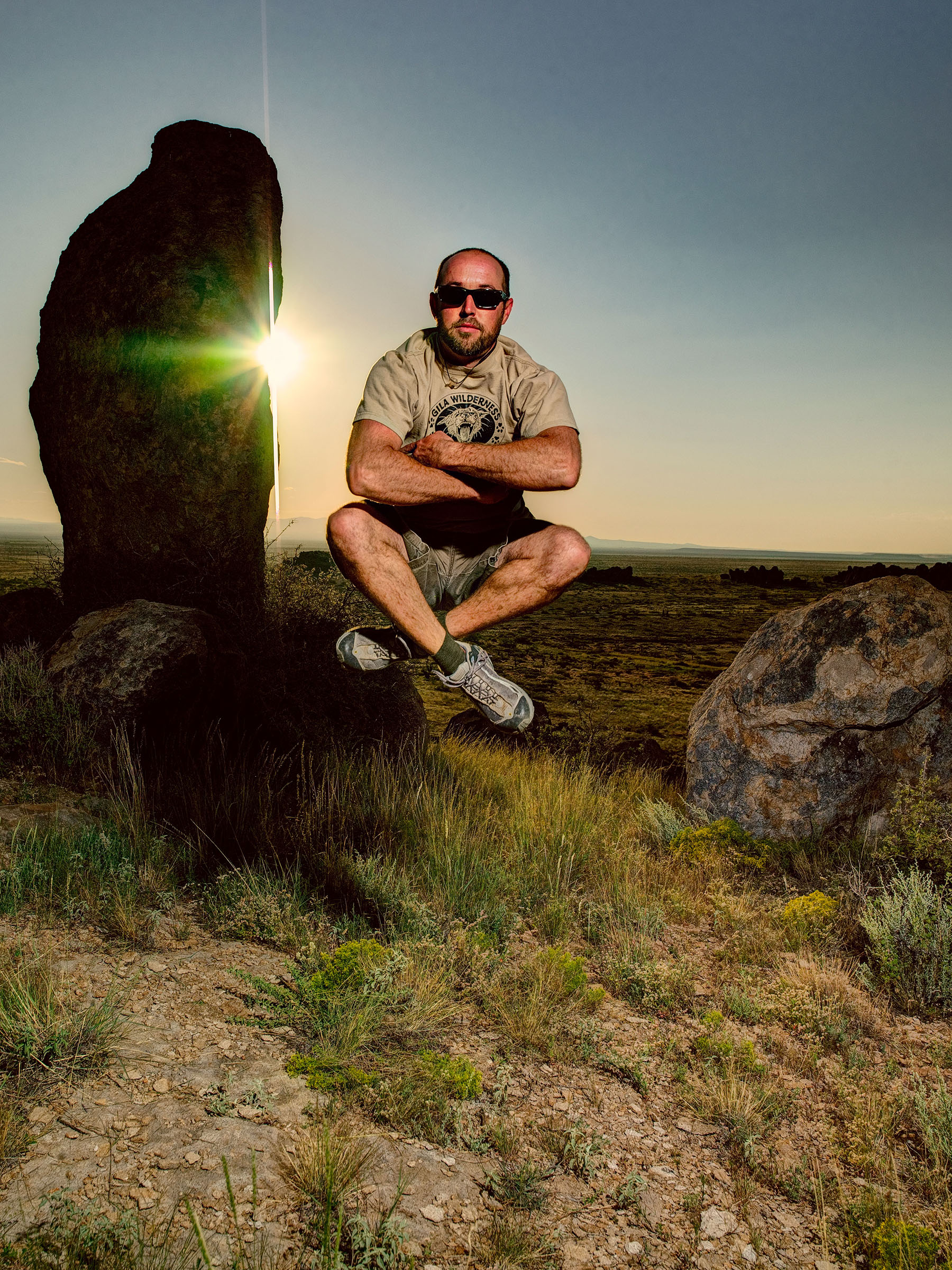 Aari Werber throws a buddha pose, City of Rocks, NM, Wick Beavers Advertising Photographer NYC